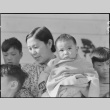 Issei woman and children awaiting mass removal (ddr-densho-151-113)