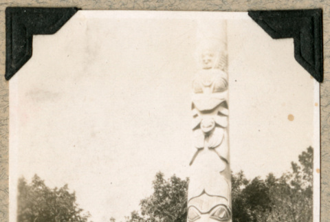 Two men in front of a totem pole (ddr-densho-383-43)