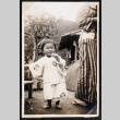 Toddler holds on to a fence (ddr-densho-404-3)