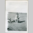 A toddler riding a tricycle (ddr-densho-300-79)