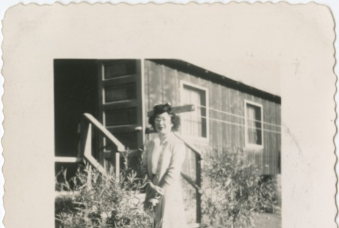 Woman standing in Heart Mountain concentration camp (ddr-densho-321-58)