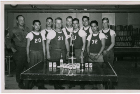 Photo of men standing with trophy (ddr-densho-399-22)