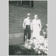 Man and woman standing in front of house (ddr-densho-332-21)