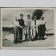 A group holding salmon (ddr-densho-201-994)