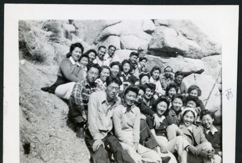 Photograph of a group of people sitting on rocks in the Sierra Nevada (ddr-csujad-47-297)