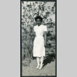 Photograph of a nurse posing in front of a tree at Manzanar (ddr-csujad-47-191)