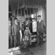 Three Issei men and child outside the Mitsuwado store (ddr-densho-13-2)
