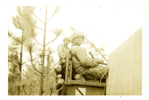 Soldiers sitting in a truck (ddr-densho-22-206)