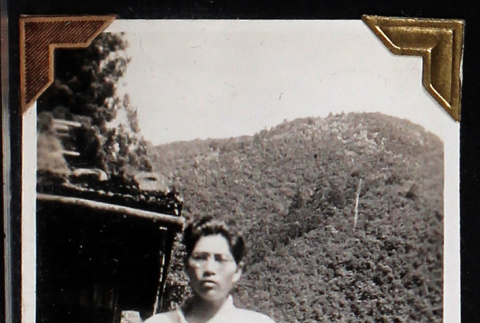 Tokeo Tagami stands at the foot of a mountain (ddr-densho-404-16)