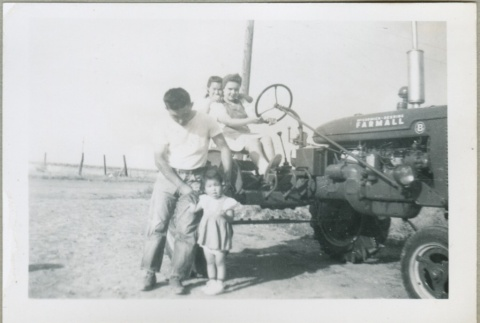 Riding on a tractor (ddr-densho-300-141)