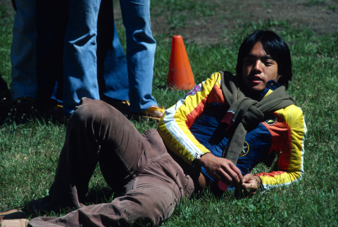 Perry Tong laying in the grass (ddr-densho-336-1347)