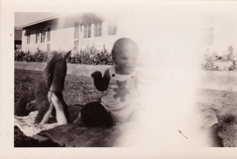 A toddler playing outside (ddr-densho-315-4)