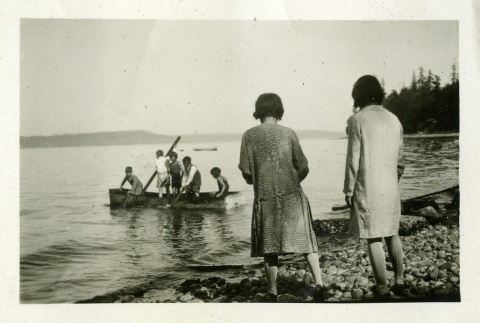 Children playing in water with rowboat (ddr-densho-182-86)