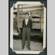 Man poses in front of truck (ddr-densho-359-1062)
