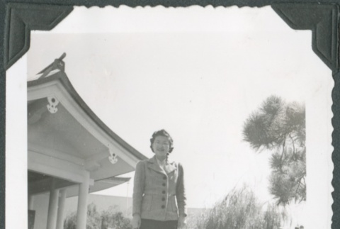A woman outside of the Japan Pavilion at the Golden Gate International Exposition (ddr-densho-300-207)