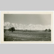 Photograph of Manzanar with snow on the ground and guard tower in the background (ddr-csujad-47-336)