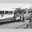 Indonesians leaving buses at the Southern Pacific depot in San Francisco, to board a train to take them to the immigration detention facility at Crystal City, Texas (ddr-csujad-27-6)