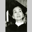 Photograph of Michi Weglyn in a graduation cap and gown (ddr-csujad-24-163)