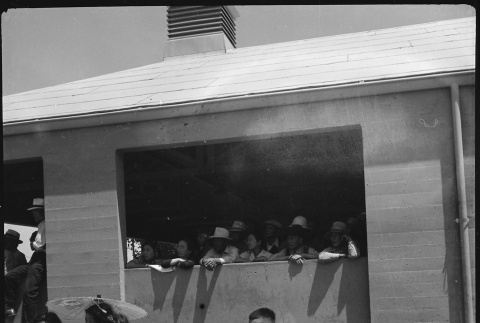 Young Japanese Americans waiting for new arrivals (ddr-densho-151-255)