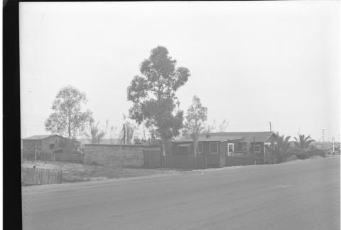 House in front of Long Beach City limits sign (ddr-csujad-43-16)