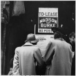 Shoppers looking at posted exclusion orders (ddr-densho-151-84)