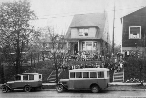 Nuns and children standing outside building with Maryknoll buses (ddr-densho-330-247)