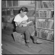 Japanese American reading in library (ddr-densho-151-435)