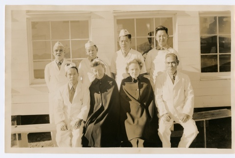 Medical personnel and nurses posing in front of a building (ddr-densho-223-49)