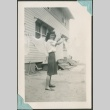 A woman hanging laundry to dry (ddr-densho-328-87)