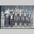 Group of boys and girls standing on steps of building (Maryknoll school) (ddr-densho-330-229)
