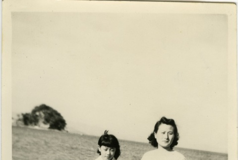 Mother and daughter on the beach (ddr-densho-113-53)