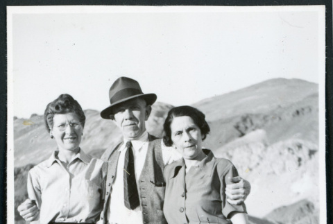 Photograph of three people standing at Zabriskie Point in Death Valley (ddr-csujad-47-123)