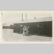 Two women standing in front of barracks (ddr-manz-7-10)