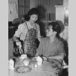 Mr. and Mrs. George Amano having breakfast in their apartment in Detroit, Michigan (ddr-csujad-14-31)