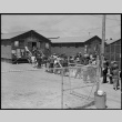 Japanese Americans waiting in mess hall line (ddr-densho-151-354)