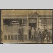 Men stand outside the Japanese Togo Employment Agency (ddr-sbbt-1-15)
