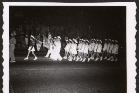 Lotus Kidettes Drill Team marches in a parade (ddr-sbbt-6-107)