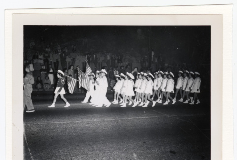 Lotus Kidettes Drill Team marches in a parade (ddr-sbbt-6-96)
