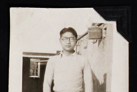 Tokeo Tagami stands outside a building (ddr-densho-404-88)