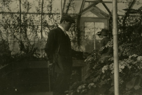 Issei man in a conservatory (ddr-densho-182-114)