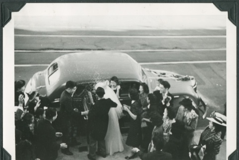 The bride and groom being seen off in a car (ddr-densho-300-235)