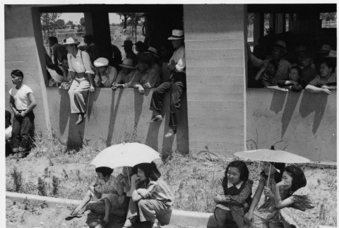 Young Japanese Americans waiting for new arrivals (ddr-densho-151-257)
