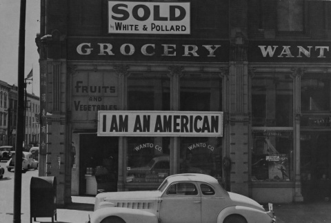 I am an American sign on the store front on December 8, 1941 (ddr-csujad-7-1)