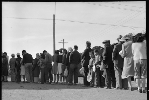 Japanese Americans waiting in mess hall line (ddr-densho-151-348)