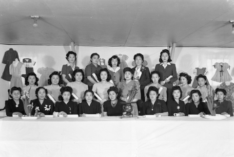 Group photo at a sewing exhibit in camp (ddr-fom-1-682)