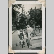 Boy and girl on trike and scooter respectively (ddr-densho-321-138)