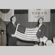 Two Rotarians, from Honolulu and Tokyo, holding an American flag (ddr-njpa-2-353)