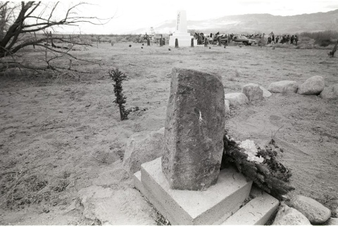View of a ceremony at the Manzanar Cemetery Monument (ddr-manz-3-25)