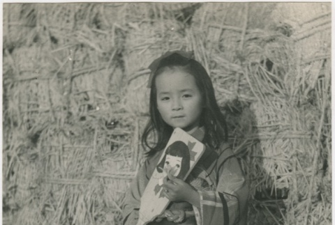 Young Japanese girl dressed in a kimono (ddr-densho-299-181)