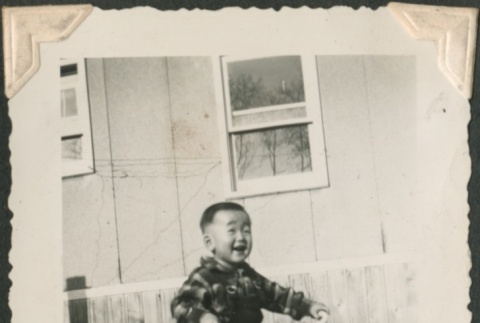 Toddler riding a tricycle (ddr-densho-321-237)